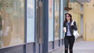 Happy young urban woman drinking coffee in european city. Travel tourist woman Stock Footage
