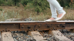Girl walking on the railroad Stock Footage