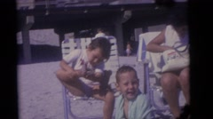 1964: the young boy cleans off his foot with passion to stay clean CAMDEN Stock Footage