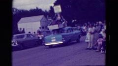 1965: multiple cars in a homecoming parade CLARKSON, NEBRASKA Stock Footage