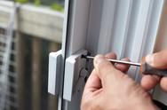 Door lock installation. Stock Photos