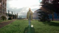 Girl posing to the camera, sun glare 2 Stock Footage