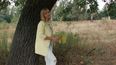Romantic walk girl in the autumn forest Stock Footage