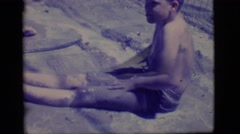 1968: two young boys rolling around in disgusting water COTTONWOOD, ARIZONA Stock Footage