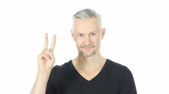 Victory Sign by Confident Middle Aged Man, White Background Stock Footage