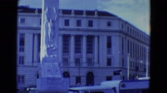 1969: beautiful and unique statue stands in front of an impressive building  Stock Footage