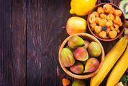 Fresh fruit on the wooden table, autumn fruits Stock Photos