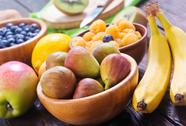 Fresh fruit on the wooden table, autumn fruits Stock Photos