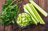 Fresh celery in glass bowl on a table Stock Photos
