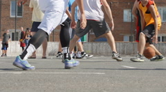 Struggle in streetball on a court - feet level (slow motion) Stock Footage