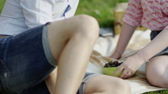 Eating cherries on a picnic Stock Footage
