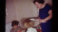 1954: family opening presents and generally being jolly OHIO Stock Footage