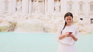 Young woman with smart phone at warm day outdoors in european city near famous Stock Footage