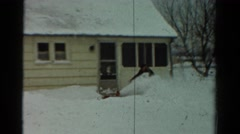 1954: man and child clearing snow with blower in front of house in yard OHIO Stock Footage