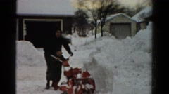 1954: father and son clearing snow OHIO Stock Footage