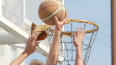 Player's hands throw a ball into a basket (slow motion) Stock Footage