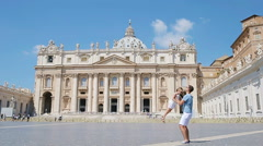 Happy young family at St. Peter's Basilica church in Vatican city, Rome. Travel Stock Footage