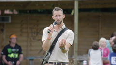 4K Handler at falconry centre talking to audience during falconry demonstration. Stock Footage