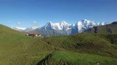 CINEMATIC FLY OVER OF HIKERS ON RIDGE IN INTERLAKEN SWITZERLAND Stock Footage