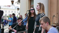 4K . Street ensemble in city with  singing girl and crowd of people .Ukraine,  Stock Footage