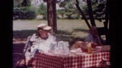 1954: outdoor party walking garden play enjoyment talking family OHIO Stock Footage