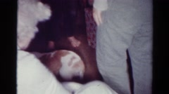 1954: dog plays with its family between presents and an old lady OHIO Stock Footage