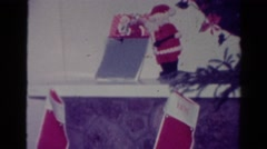 1954: vintage home video of christmas decorations such as stockings, figurines Stock Footage