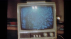 1954: a portable television sitting on furniture plays next to a christmas tree Stock Footage