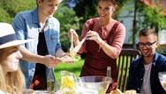 Happy friends having dinner at summer garden party Stock Footage
