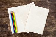 Four color pencils on paper background Stock Photos