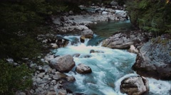 Mountain River. Water is blue. Bright colors. Stock Footage