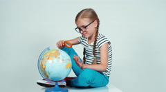 Portrait school girl spinning her globe and looking at camera isolated on white Stock Footage