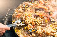Preparing Paella rice and fish Stock Photos