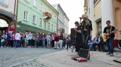 4K . Street girl Soloist of ensemble executes rock music Stock Footage