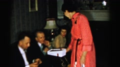 1956: a woman distributes snacks between several people sitting NEW YORK Stock Footage