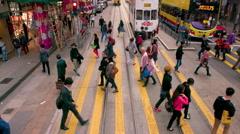 PEDESTRIANS CROSSING WAN CHAI HONG KONG CHINA Stock Footage