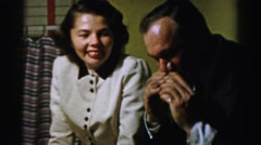1956: a man aggressively taking a bite out of a sandwich as a woman watches  Stock Footage