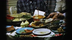 1956: man is being greedy at the dinner party NEW YORK Stock Footage