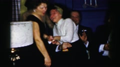1956: a party with couples and women are laughing NEW YORK Stock Footage