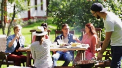 Friends having barbecue party at summer garden Stock Footage