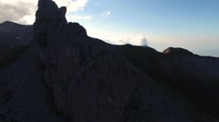 Reverse aerial of Lobhorn rock cliff in Swiss Alps Stock Footage