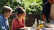 Friends gathering for dinner at summer garden Stock Footage