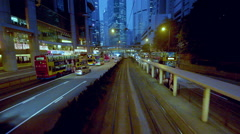 TRAMS BUSES ON QUEENSWAY CENTRAL HONG KONG CHINA Stock Footage