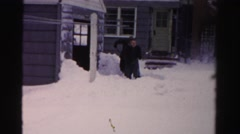 1956: two people shoveling knee-deep snow outdoor of a house NEW YORK Stock Footage