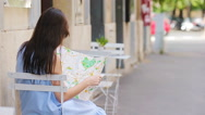 Beautiful woman looking at touristic citymap in Rome, Italy. Happy girl enjoy Stock Footage