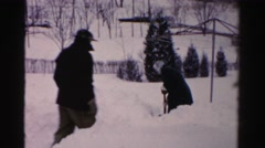 1956: man sneaks up on woman shoveling snow in yard NEW YORK Stock Footage