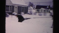 1956: shoveling deep snow outdoor a house NEW YORK Stock Footage