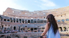 Young female tourist looking at the Colosseum inside in Rome, Italy. The Stock Footage