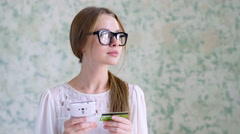 Positive girl with telephone and bank card Stock Footage