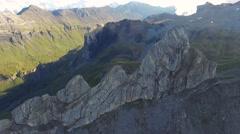 CINEMATIC PAN OF SNOW CAPPED MOUNTAIN PEAKS IN SWIZTERLAND Stock Footage